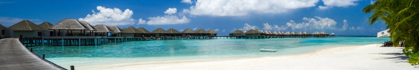 Scenic views of the overwater villas in the shallow water in Maldives
