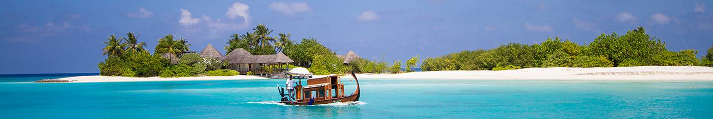 View of a holiday bungalow in an isolated island surrounded by the sea at Maldives