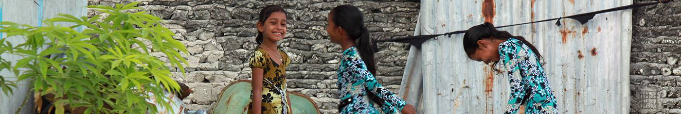 Random click of three native girls chatting