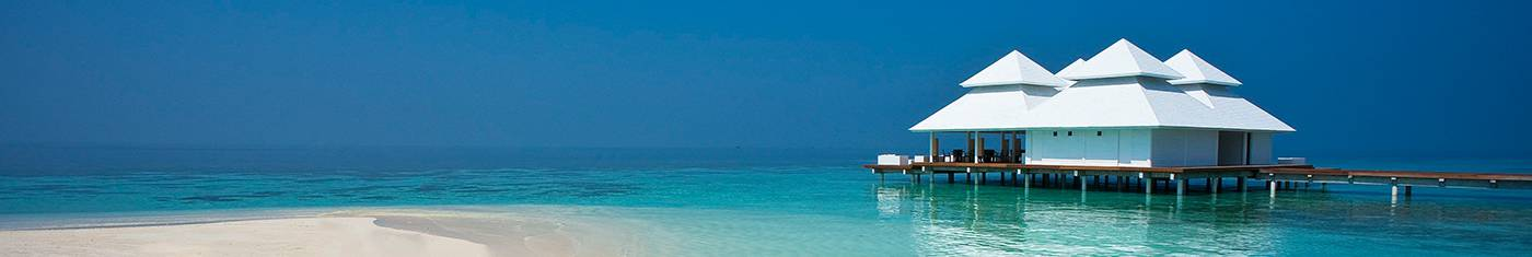 Distance view of an isolated water bungalow on Maldives waters