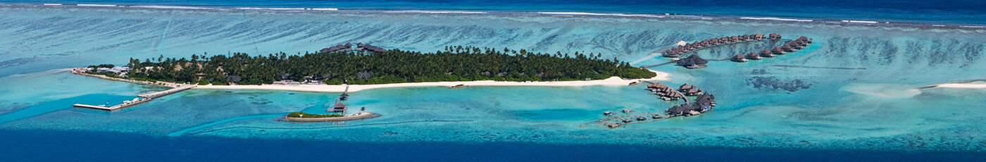Arial views of Maldives Islands with overwater beach villas