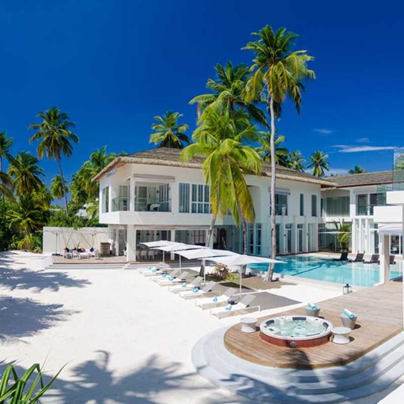 Distance view of the Maldives hotels with outdoor swimming pool and relaxing sun beds