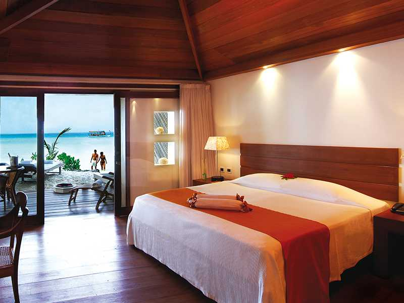 Beach bungalows in Maldives with wooden flooring