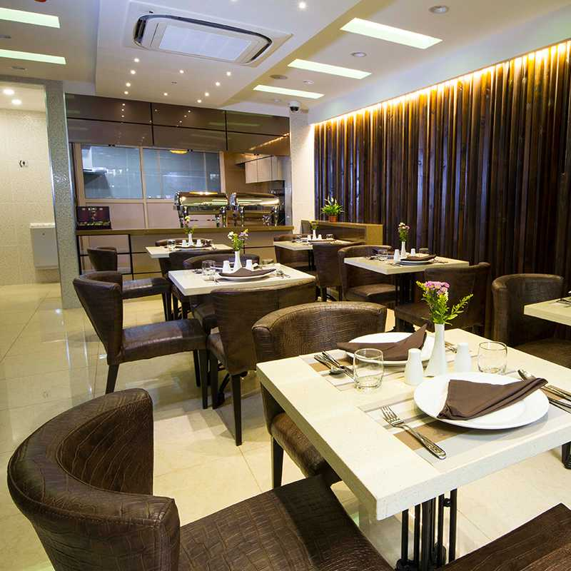 Views of the fine dining areas with arranged tables in Maldives hotels