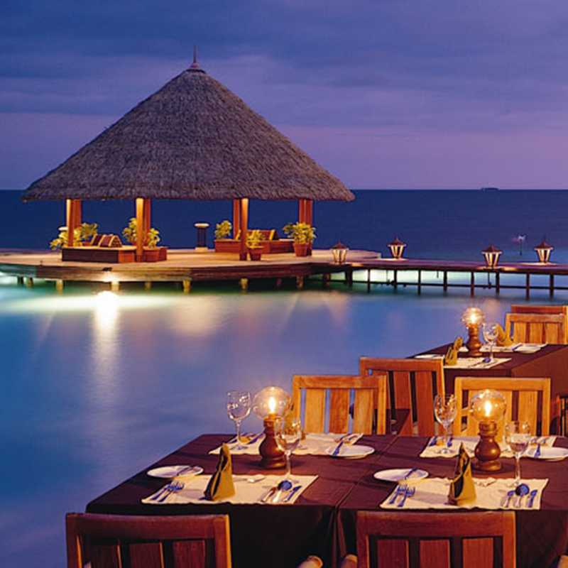 Distance view of the over water dining area at Rivali Maldives