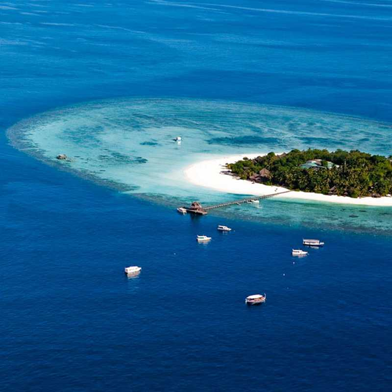 Arial view of the isolated island in Maldives with cruises