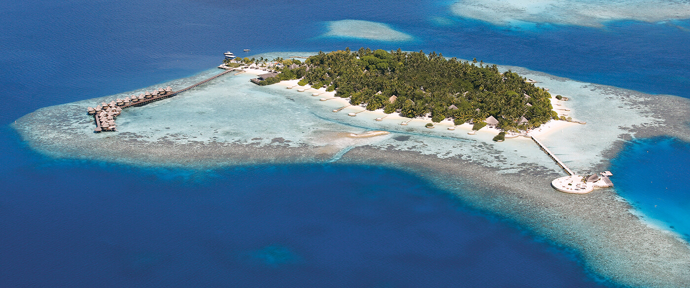 Arial view of Maldives islands with overwater suits around it