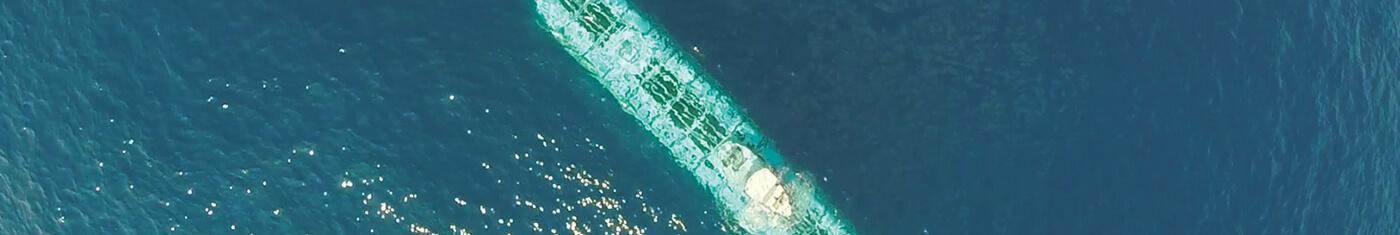 Submarine cruising in free water in Maldives sea