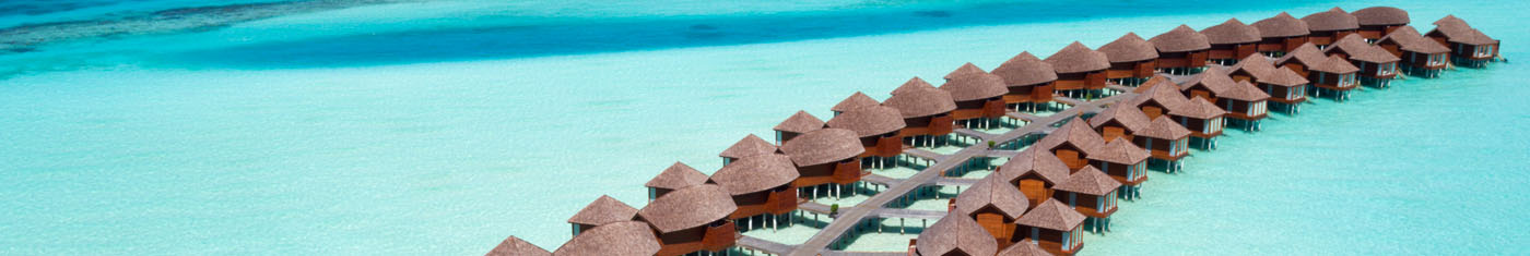 Arial view of the overwater villas in Maldives sea for a exclusive vacation