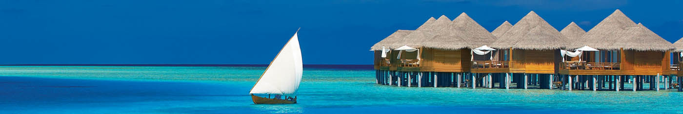 Sights of the overwater villas with cone shaped roofing in Maldives