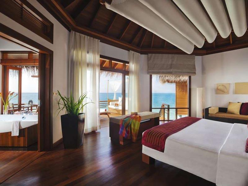 elegant interior views of the Baros Water Villa