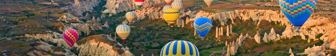 View of hot air ballooning in the sky with plenty of multi colored balloons