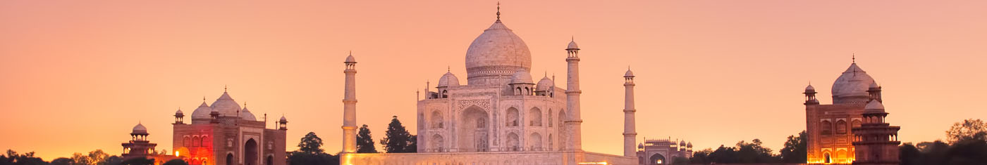 View of the Taj Mahal with two identical buildings beside it