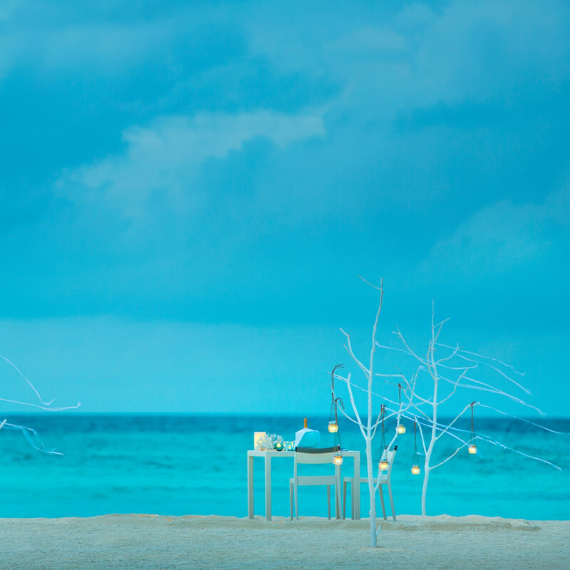 Distance view of the private dining table in the beach
