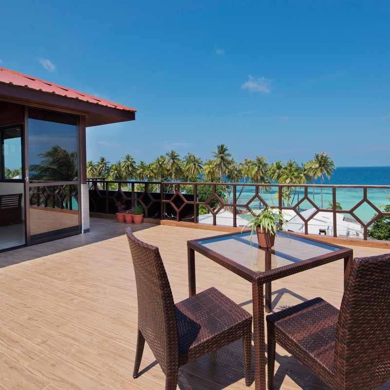 Hotel balcony area with scenic views of the beach in Maldives