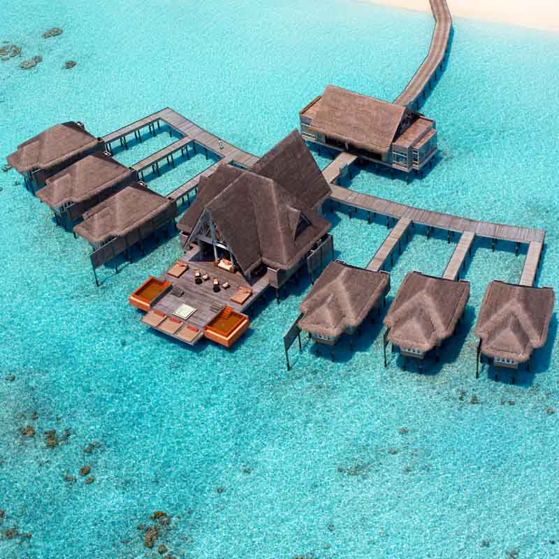 Arial view of the Kihavah hotel with relaxing over water bungalows