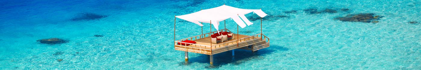 Distance views of overwater relaxing suits with comfy sofa